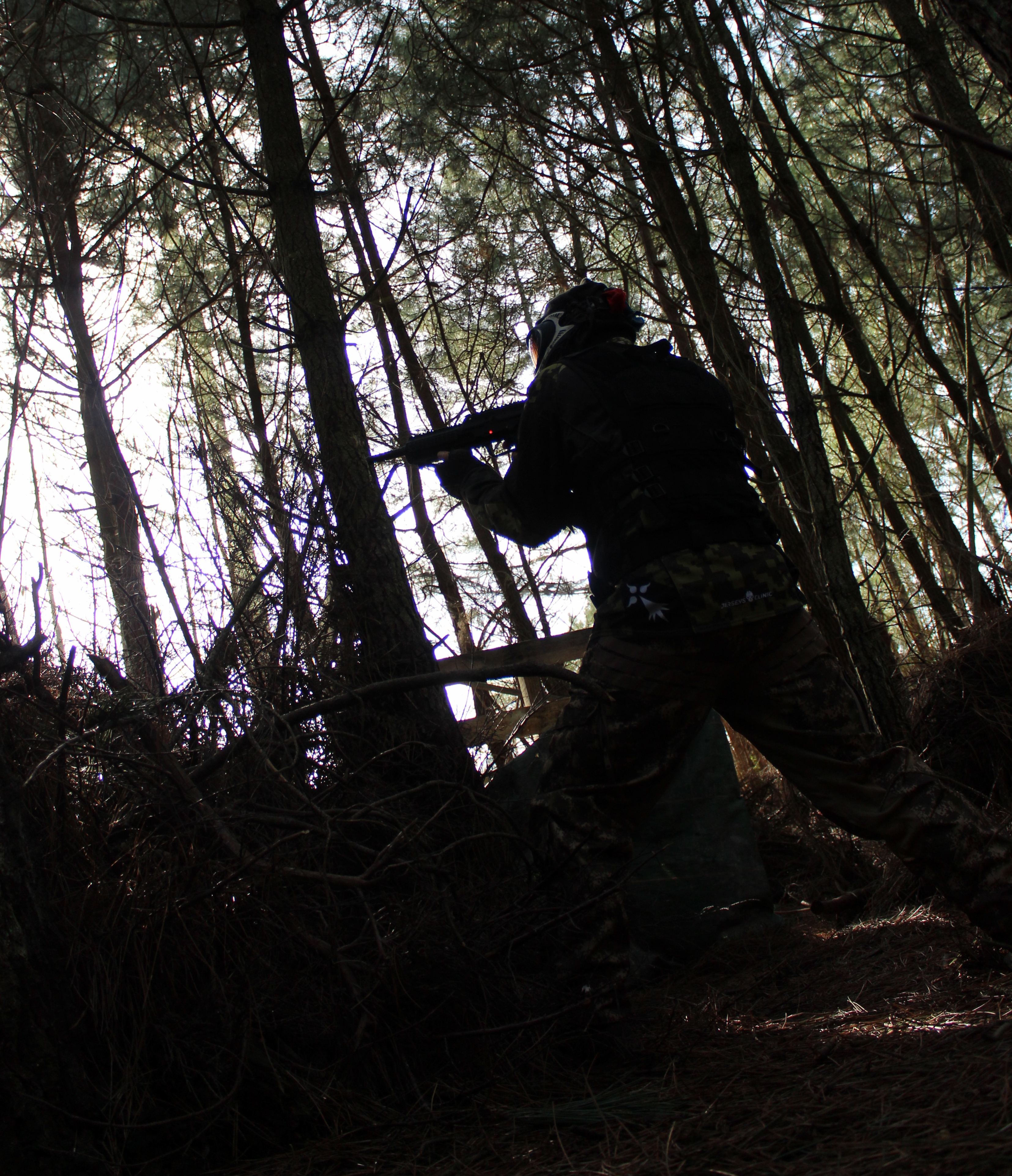 playing paintball in forest